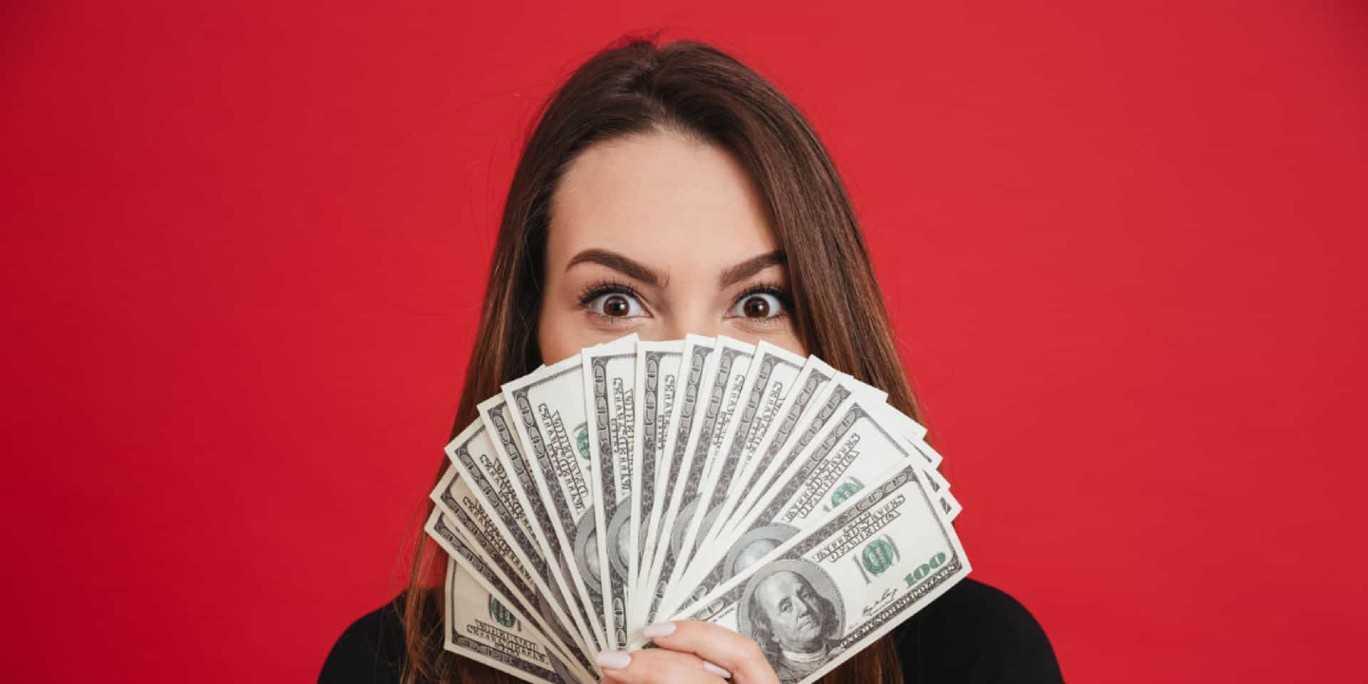 Girl Fans 100 Dollar Bills Excited